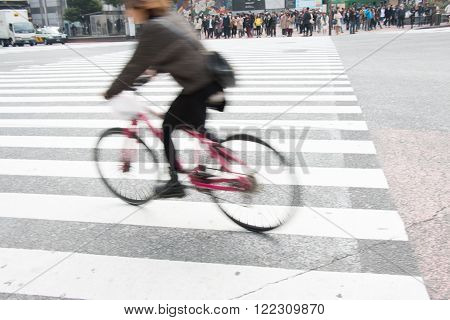 Motion Blurred Biker Bicycle Ride Across Pedestrian