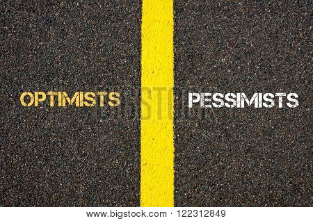 Antonym concept of OPTIMISTS versus PESSIMISTS written over tarmac, road marking yellow paint separating line between words