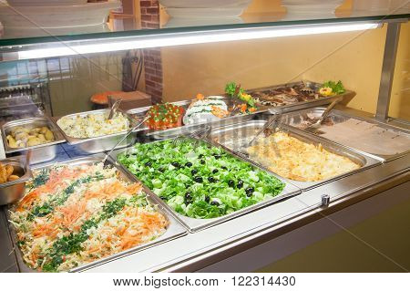 take-out food in showcase window. Catering industry
