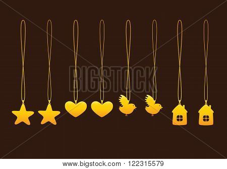 Set of golden pendants with two types of chains isolated on brown background. Pendants in shape of star heart bird and house