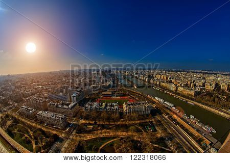 Warm Sunset over Paris cityscape shot from Eiffel Tower