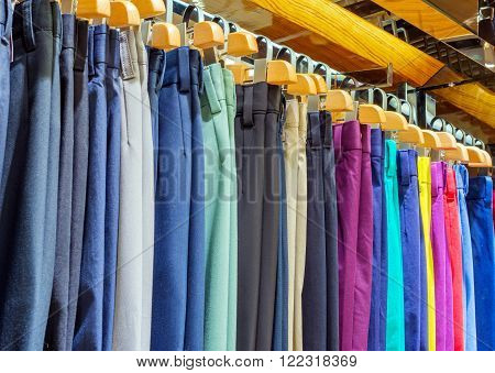 Colorful pants hung on the supermarket shelves