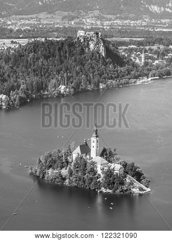 Lake Bled with St Mary's church on the island and Bled castle, Slovenia. Black and white image.