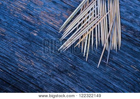 A lot of toothpicks on wood background