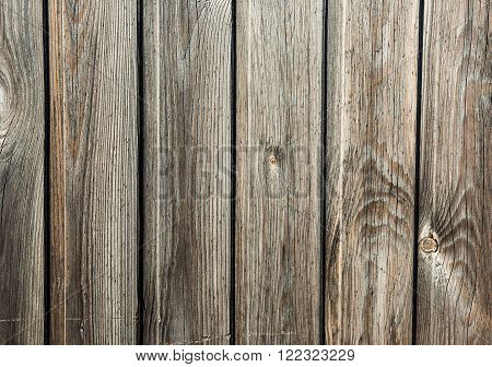 vertical wooden slats with bright knots old frayed