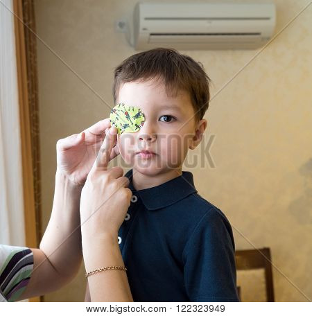 Eye patch. Portrait of a boy. Ophthalmology.