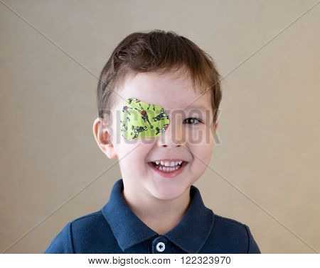 Eye patch. Portrait of a boy. Ophthalmology.