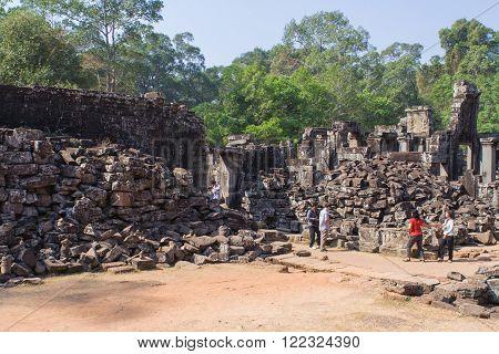 Angkor Wat Siem Reap Cambodia - Februaty 10 2015 :: Tourists walking in Angkor Wat Siem Reap Cambodia
