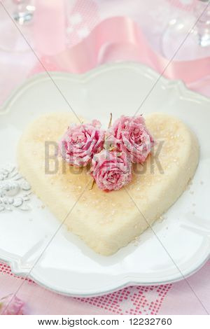 Heart-shaped ricotta dessert with candied roses for Valentine's Day