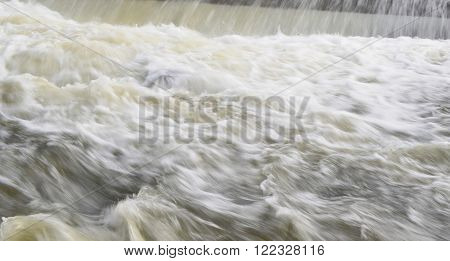 rapidly flowing water on the winter river . South Bohemia, Czech Republic