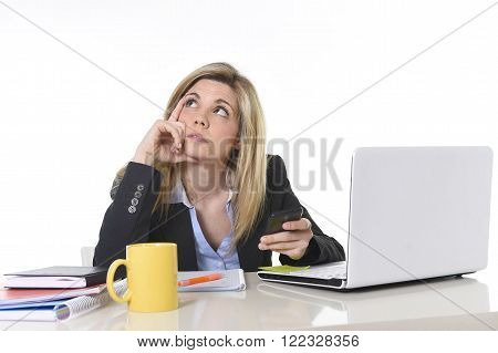 young beautiful businesswoman suffering stress working at office computer desk feeling tired and bored looking overworked using mobile phone in business mess