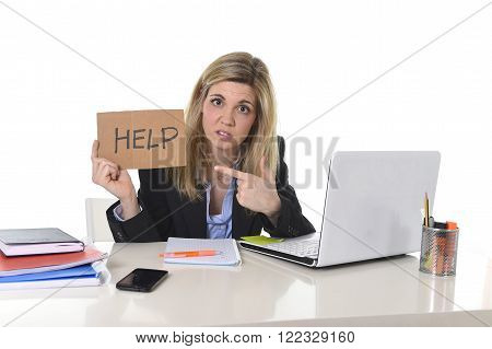 young businesswoman tired holding help sign looking overwhelmed suffering work stress sitting at office computer desk