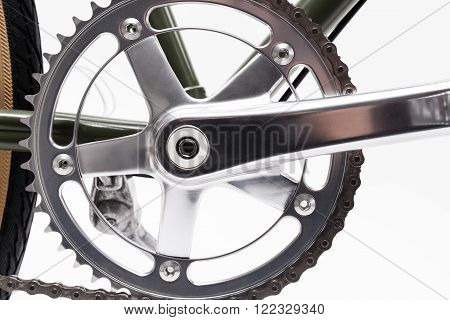 Composition with one speed Vintage bicycle crank isolated on white.