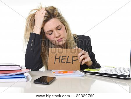 young beautiful business woman suffering stress working at office computer desk asking for help feeling tired and desperate looking overworked pulling her hair overwhelmed and frustrated