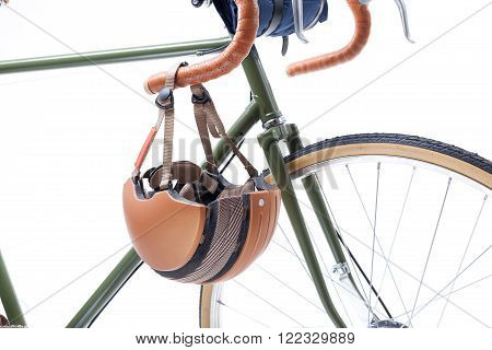 Vintage road bicycle handlebar and helmet on it, isolated on white.
