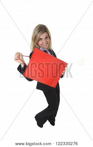 young beautiful woman in business suit in excited face expression holding red shopping bag isolated on white background looking happy having fun in shopaholic and sales concept