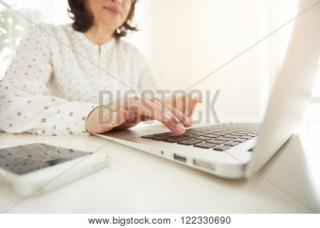 Closeup Of Businesswoman Typing. Beautiful Asian Mature Woman's Hands Busy Working On Laptop Com