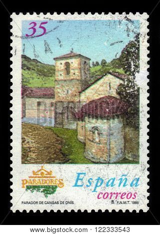 SPAIN - CIRCA 1999: a stamp printed in Spain shows Parador of Cangas de Onis (Asturias). Former monastery of San Pedro de Villanueva, circa 1999