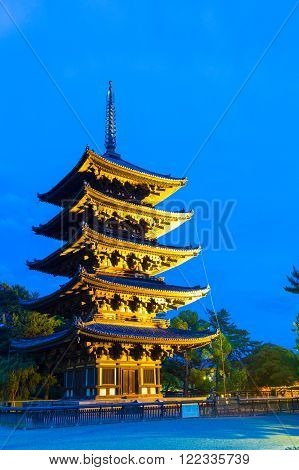 NARA, JAPAN - JUNE 25, 2015: Beautiful blue sky and lighted five story pagoda goju-no-to at evening blue hour in Kofuku-ji temple complex in Nara Japan