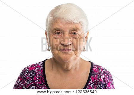 Portrait of elderly woman with white hair on white background