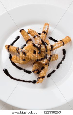 Churros On Plate With Chocolate
