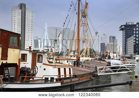 ROTTERDAM, THE NETHERLANDS - 18 AUGUST: Old cranes in Historical Leuvehaven, Rotterdam's oldest sea port. Harbor and modern apartment buildings in Rotterdam, Netherlands on August 18,2015.