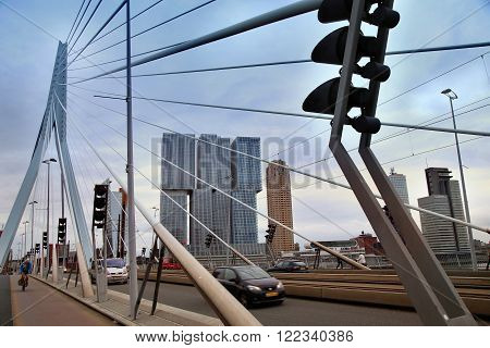 ROTTERDAM THE NETHERLANDS - 18 AUGUST: Rotterdam is a city modern architecture. Cars traffic driving and bicyclists crossing on the Erasmus bridge (Erasmusbrug) in Rotterdam Netherlands on August 182015.