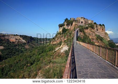 Beautiful panoramic view of famous Civita di Bagnoregio with Tiber river valley in golden evening light Lazio Italy