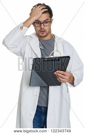 A young doctor at a loss isolated on white