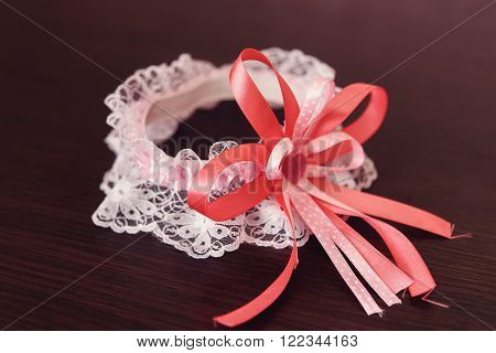 White Stylish Sexy Garter And Pink Ribbon Closeup