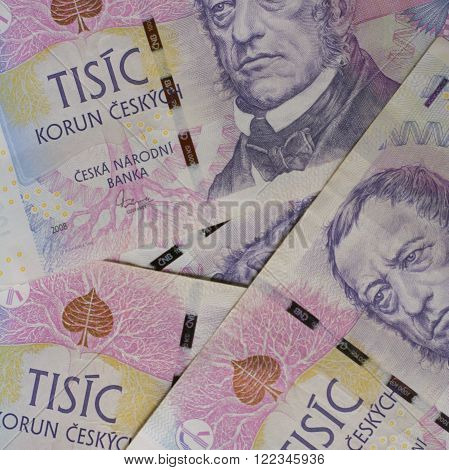 Czech bank notes (thousands) with the painting of famous writer Frantisek Palacky scattered on the table. Square photo.