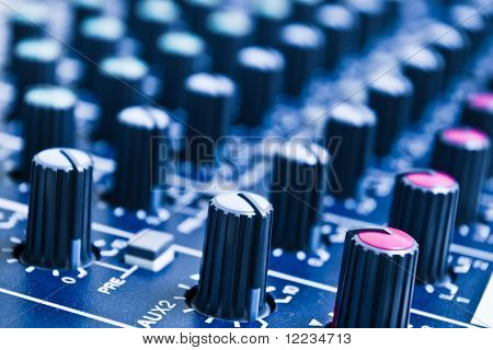 audio mixer knobs with shallow depth of field