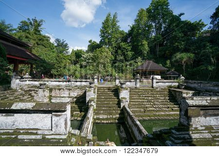BALI, INDONESIA - MARCH 14: People visit the ancient holy temple of Pura Gua Gajah on March 14, 2016 in Bali, Indonesia.