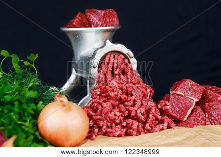 Mincer with fresh minced beef meat with vegetable