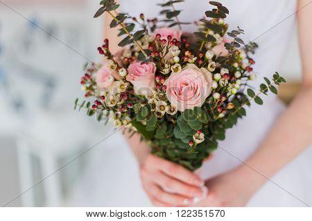Bride with beautiful wedding bouqet closeup shot