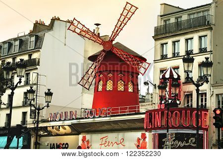 PARIS FRANCE - OCTOBER 05 2008: Moulin Rouge and street view in Paris. It is the most-visited paid monument in the world with annual 250M visitors.