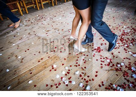 Couple dancing on a dance floor during a wedding celebration/party (motion blurred image)