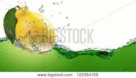 Ripe citrus lemon,amid a spray of juice.