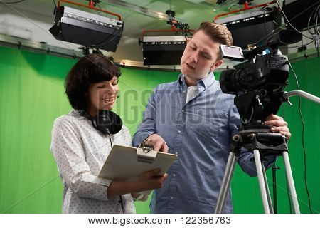 Cameraman And Floor Manager In Television Studio