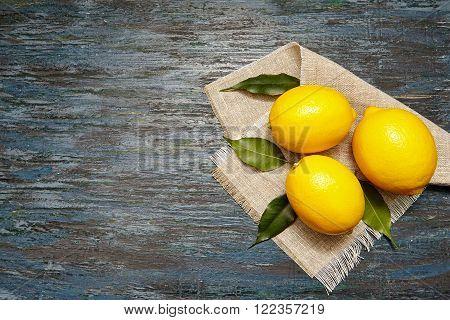 Fresh lemons on a linen napkin