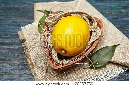 lemon with a linen rope in the plate