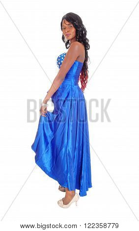 A lovely African American woman in a long blue evening dress with curly