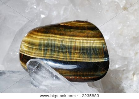 Tiger Eye Laid On Druze Of Quartz