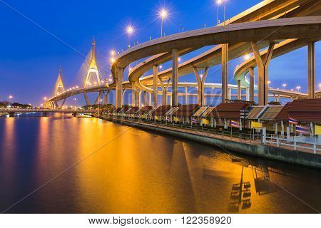 Twilight over, Suspension bridge connect to highway water front, Bangkok Thailand