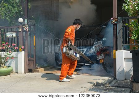 Bangkok, Thailand - January 31, 2016 : Unidentified people fogging DDT spray kill mosquito for control Malaria, Encephalitis, Dengue and Zika in village at Bangkok Thailand.
