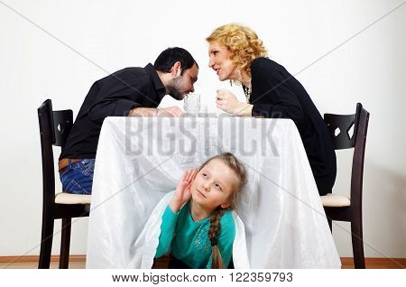 little girl listening to the adults secrets