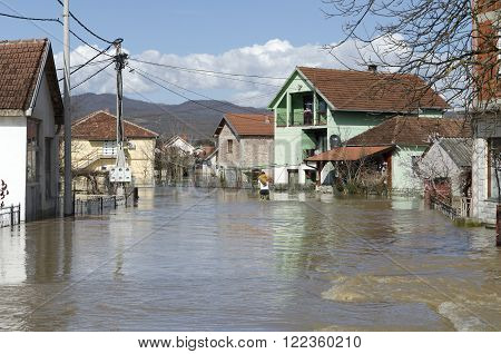 KRALJEVO, SERBIA - MARCH 8. 2016: Flood victims go to see what happen with their houses after heavy rain and the river Morava flooded at Kraljevo, suburbs Grdica, on 8th March 2016.