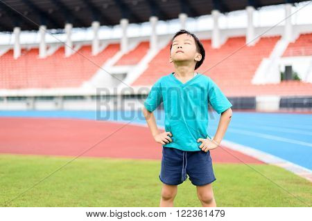 Boy Stand On The Football Field.