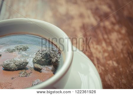 Beach and tropical sea with rock in nature reflection on coffee , process in vintage style