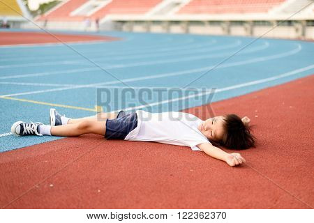 Boy Lay On The Running Track